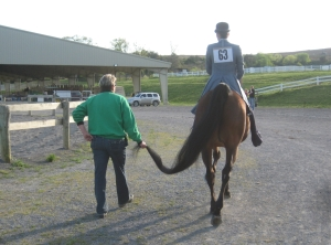 Mother, daughter, & horse get ready to show.