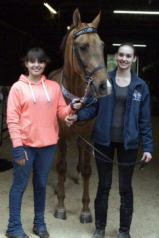 Katie (right) and her sister, Olivia Grace, welcome their new horse Froggie Went A Courtin' (Mooney). Photo by Terri Croxton